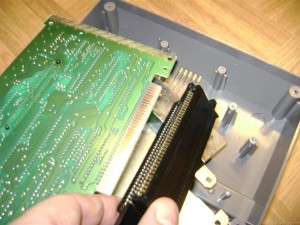 Pulling the 72 pin connector off the Nintendo NES motherboard