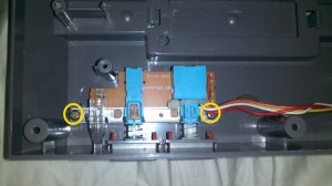 View of the 2 screws that secure the power-reset board in the Nintendo NES