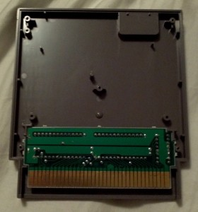 View of the inside of a regular 5 screw NES game