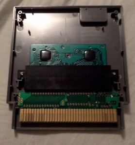 View of inside a 5 screw NES Game containing a Famicom Converter